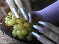 Long silver nails playing