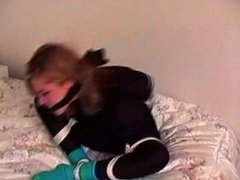 Left bound and gagged in her shiny spandex by an intruder