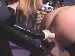 Rubber Mistress strapon fuck slave