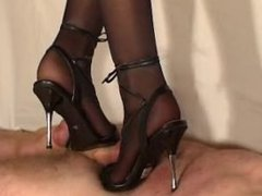 Trample torture with metal heels