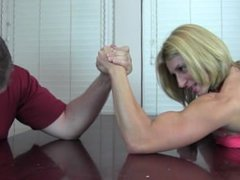 Goddess Rapture armwrestles her step dad and makes him her bitch