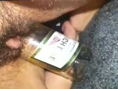 Babe fucks her Pussy with a Bottle