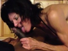 Naughty MILF blowing a Big black Cock