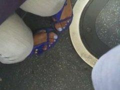 Candid shy ebony feet on bus
