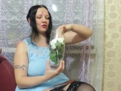Girl fills by urine vase with chrysanthemums
