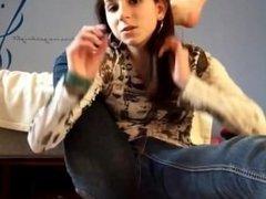 Girl putting feet behind her head in slomo