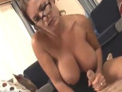 Goldie Blair with huge tits wanks off guy in shirt