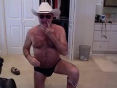 Hairy hot mature man dancing and unloading his hot cock