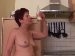 Drunk mature redhead fucks herself with a bottle.