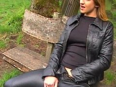 Blonde in leather pants and leather jacket masturbating outdoors