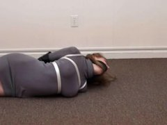 Blonde babe bound and gagged in high heels and gloves (part 1)