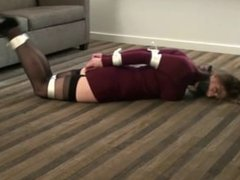 Hot brunette hogtied and gagged in a sweaterdress and high heels