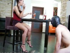 Young perfect mistress feed slave