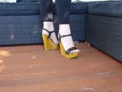 Sexy feet posing in wooden wedges heels