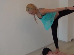 Gymnast Excercises On His Body With Her Bare Feet