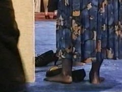 Pantyhose feet gathering. Several women in shoeless hosed feet