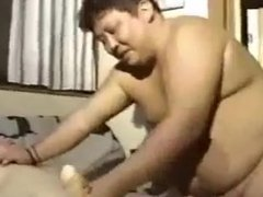 Plump japanese dad with young chubby bear