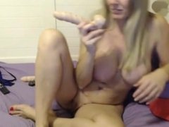 Obedient blonde milf Carly with large boobs and pierced navel