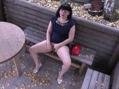 hidden camera. Brunette masturbating in a public place