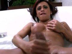 Big boobed redhead TS jerks off her massive cock in bathtub