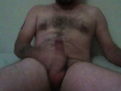 stroking cock in bed