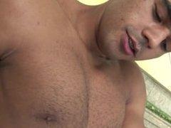 Muscle latin dude strips and masturbates