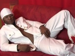 Gangster in a fancy white suit strips and masturbates