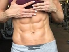 Girl flexes her perfect abs