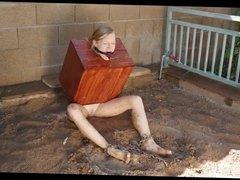 Slave girl locked in a box