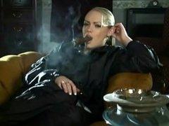 Smoking A Cigar.