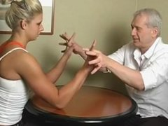 Tall woman armwrestling
