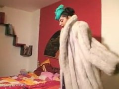 woman in fur gives blowjob