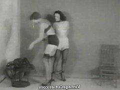 Tied up Brunette Babe in Leather Bonds (1950s Vintage)