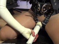 Carissa in heavy leather bondage