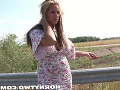 Big titted blond MILF pisses next to car to get fucked in