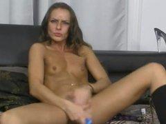 Small tits tan girl masturbates wildly for webcam