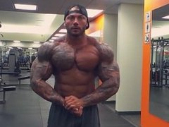 Bodybuilder posing and flexing 2 weeks out from show
