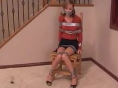 Girl duct taped on chair by lady girl
