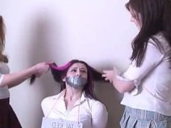 School girl tied and tape gagged on the chair by two school girls