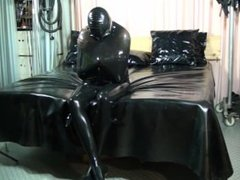 Latex Doll Wrapped in Rubber Encasement