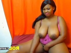 Busty ebony fingers pussy at home