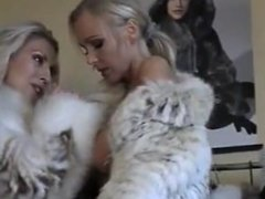Two fursluts lick each other in fur coats