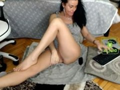 Mature brunette milf shows her long legs and feet on webcam