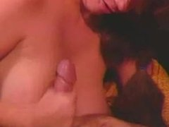 Big tittied brunette knows how to handle this cock
