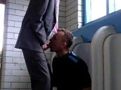 suit guy gets men's room blowjob