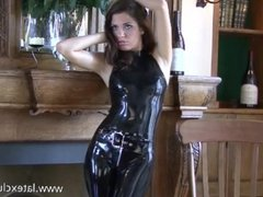 Shiny black latex outfit and fetishwear of sexy cougar Olivia posing