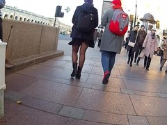 legs in black pantyhose in the street