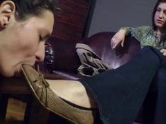 Mistress has her lesbian slave lick her shoes
