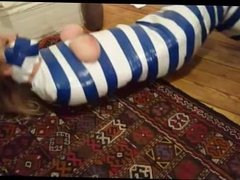 Girl mummified in duct tape struggle through apartment