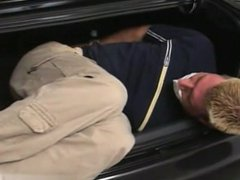 Guy tied and gagged in the trunk of a car by woman
